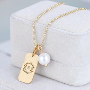 Tory Burch Pearl Eye Long Pendant Necklace